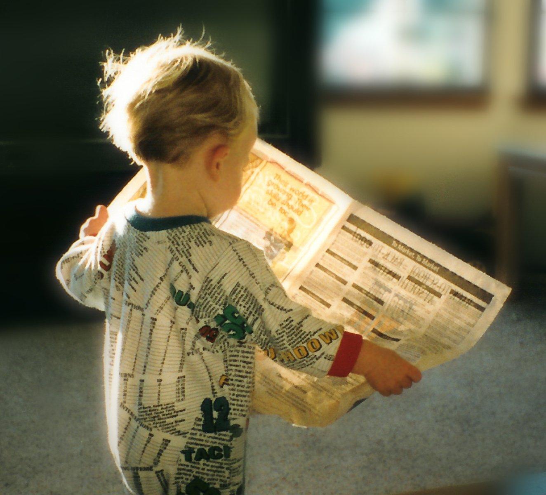 читатель с газетой картинки это современный фотоальбом
